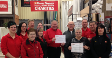 The staff and owner, Gary MacLean of Home Hardware, Grand Bend are pictured with St. Joseph and Area Historical Society representatives, Martha Mungar and Mark Tucker.
